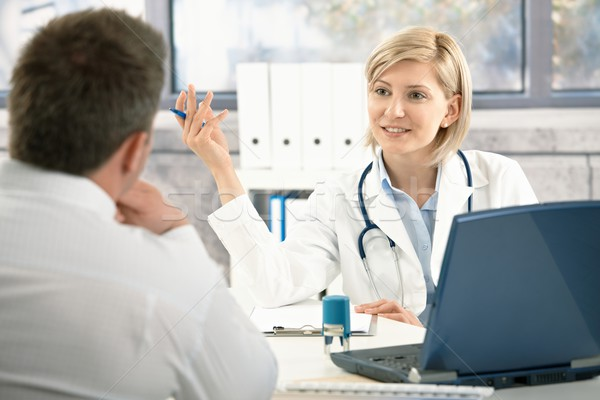 Doctor discussing diagnosis with patient Stock photo © nyul