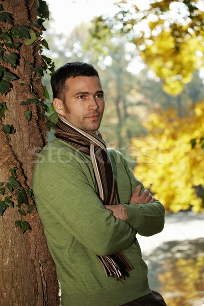 Portrait of handsome young man in autumn park Stock photo © nyul