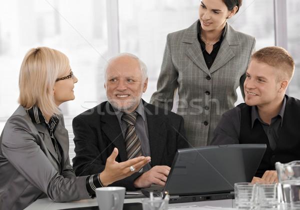 Mid-adult businesswoman talking to team Stock photo © nyul
