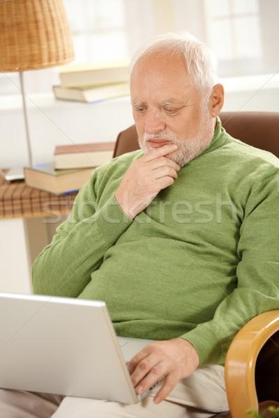 Senior man working on computer at home Stock photo © nyul