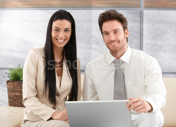 Elegant couple browsing internet at home smiling Stock photo © nyul