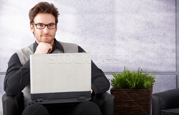 Confident businessman with laptop smiling Stock photo © nyul