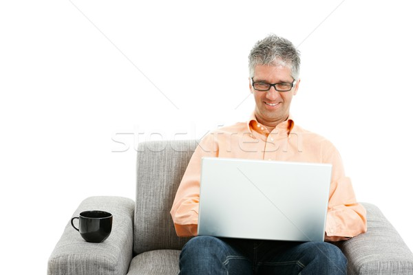 Stockfoto: Man · werken · laptop · jeans · oranje