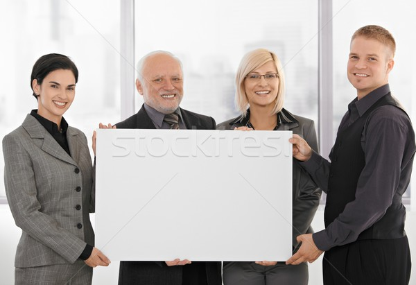 Businessteam holding blank poster Stock photo © nyul