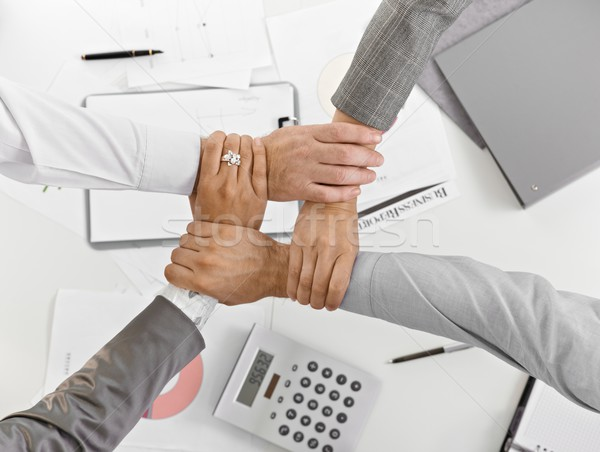 Four hands together in unity at businessmeeting Stock photo © nyul