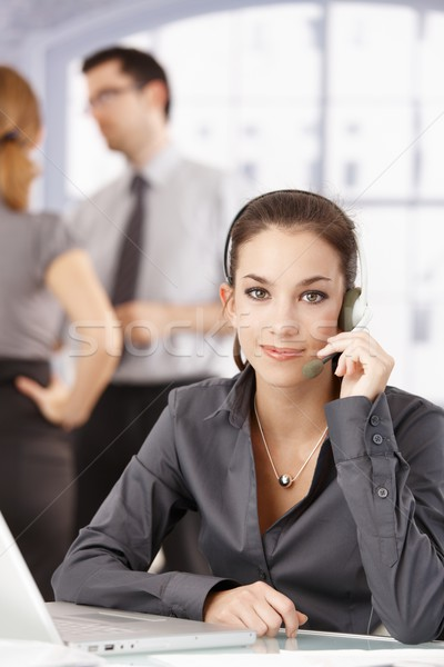 Young customer servicer using headphones in office Stock photo © nyul