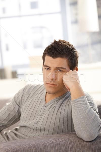 Young man thinking on sofa Stock photo © nyul