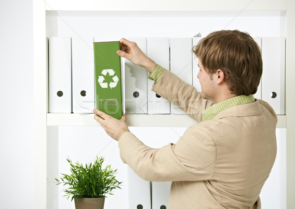 Man drawing out green folder Stock photo © nyul