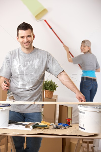 Cheerful couple painting their home Stock photo © nyul