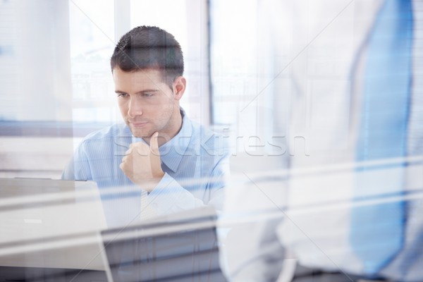 Young businessman working in bright office Stock photo © nyul