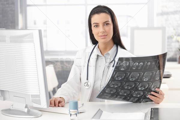 Portrait of doctor holding xray image Stock photo © nyul