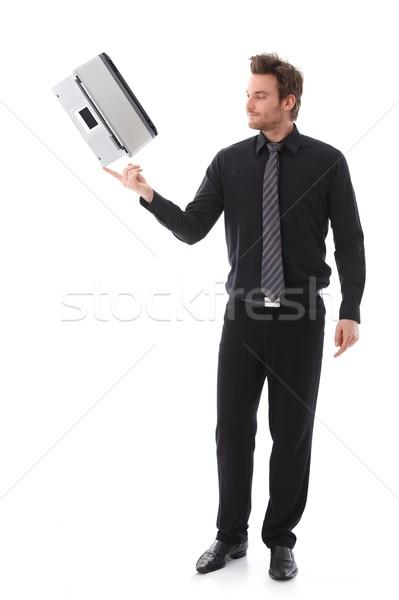 Genç dengeleme dizüstü bilgisayar genç işadamı işaret parmağı Stok fotoğraf © nyul