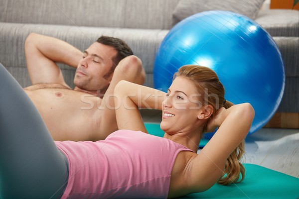 Couple doing abdominal crunch Stock photo © nyul