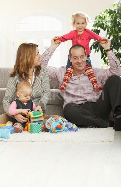 Happy family at home Stock photo © nyul