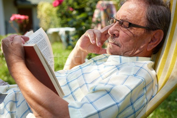 Stock photo: Old man reading outdoor