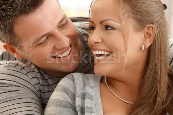 Сток-фото: смеясь · пару · красивой · глядя · счастливо · другой