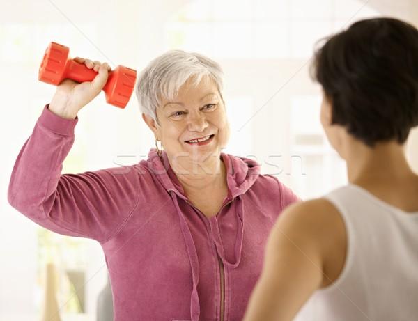 Senior woman doing dumbbell exercise Stock photo © nyul
