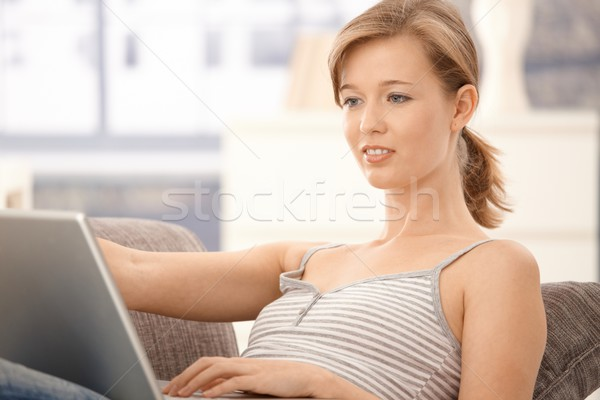 Stock photo: Casual woman browsing internet at home
