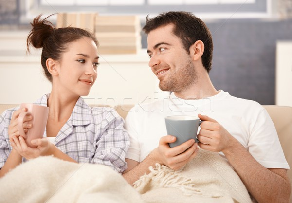 Happy couple drinking tea in bed smiling Stock photo © nyul