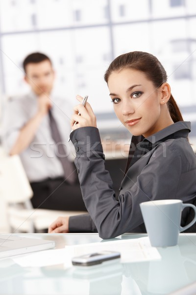 Portrait of attractive female sitting at desk Stock photo © nyul