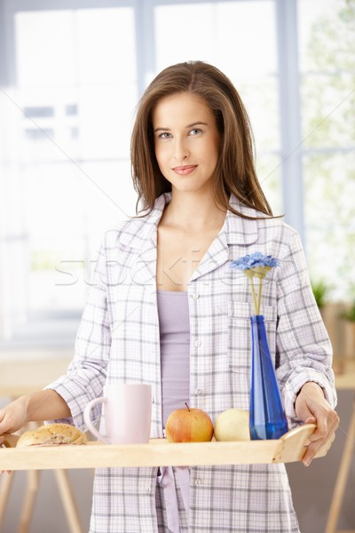 Pretty woman with breakfast tray Stock photo © nyul