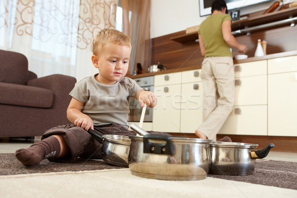 Little boy playing in kitchen Stock photo © nyul