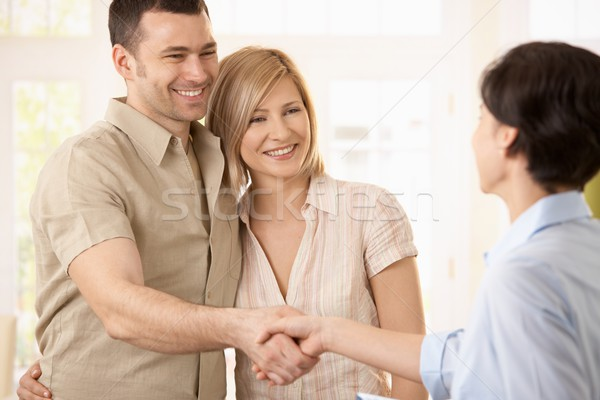 Stock photo: Couple making deal with agent