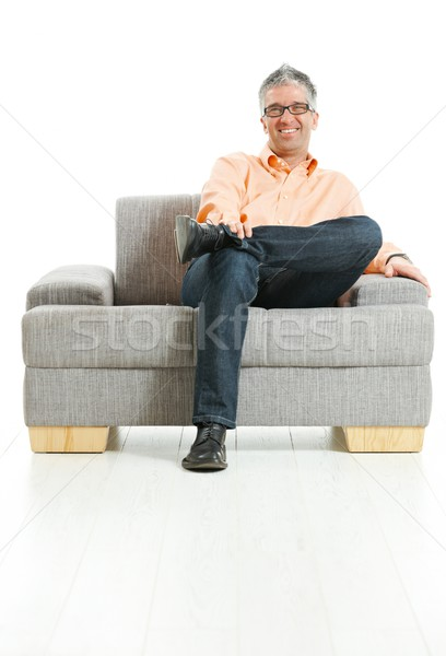 Happy man sitting on couch Stock photo © nyul