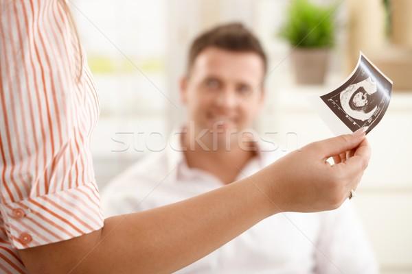 Baby's ultrasound photo handheld Stock photo © nyul