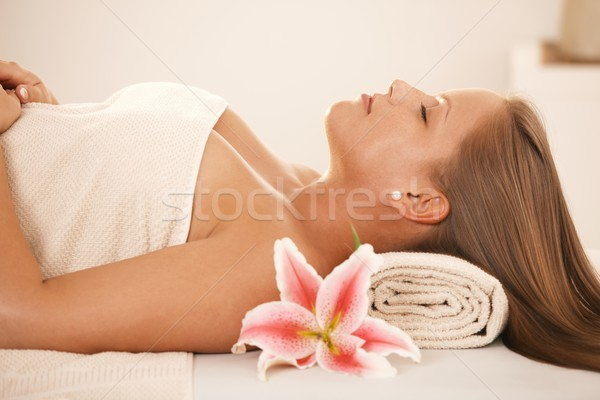 Young woman sleeping on massage bed Stock photo © nyul