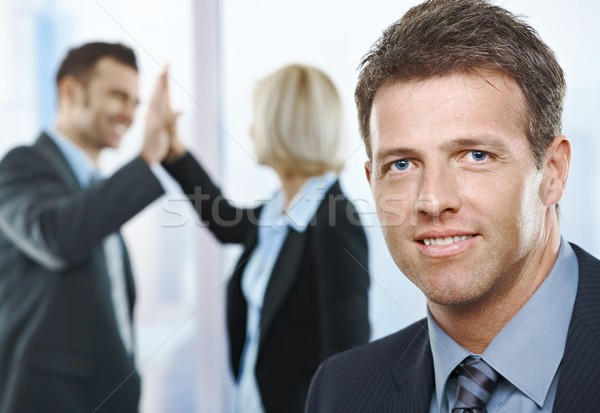 Businessman smiling at camera Stock photo © nyul
