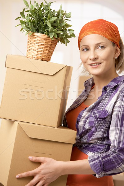 Smiling woman with boxes Stock photo © nyul