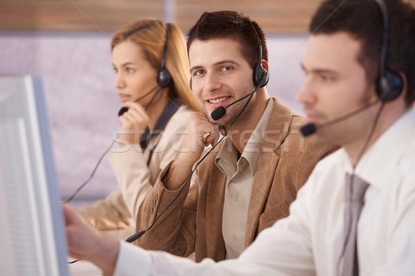 Cheerful young male dispatcher working Stock photo © nyul