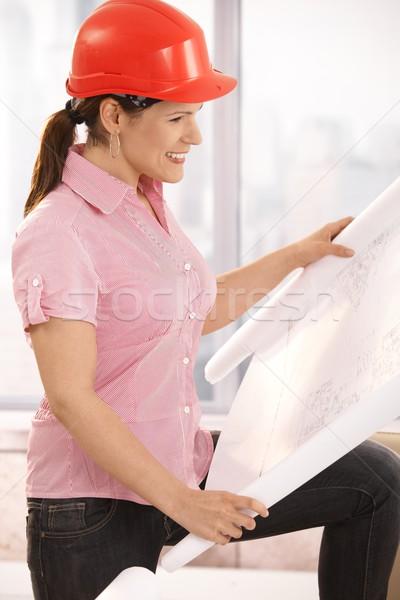Architect looking at floor plan Stock photo © nyul