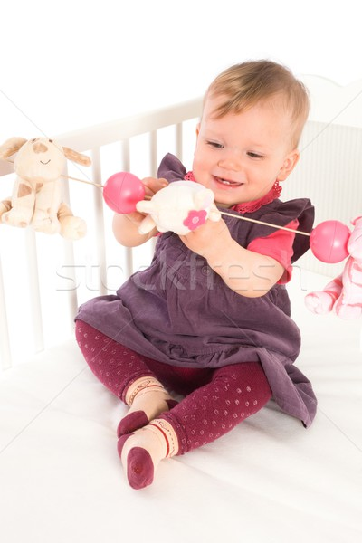 Stock photo: Baby Girl playing in bed