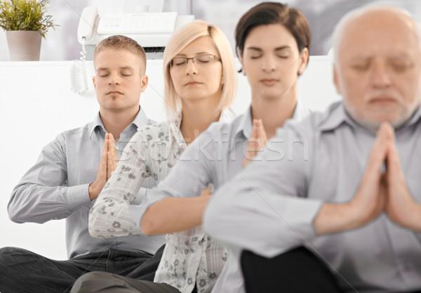 Businessteam doing yoga exercise Stock photo © nyul