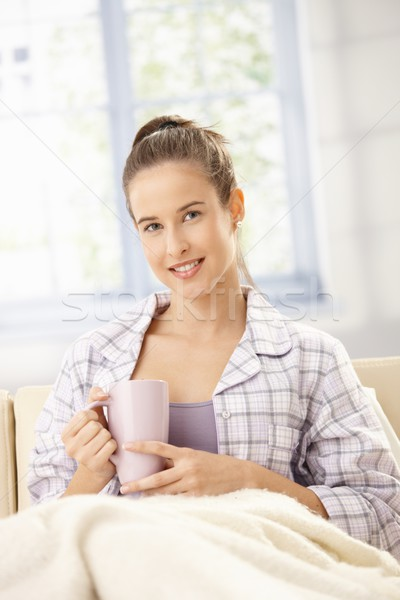 счастливым женщину утра кофе диване улыбаясь Сток-фото © nyul