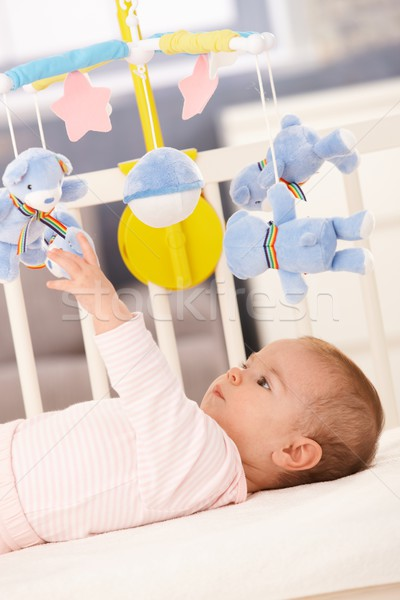 Baby girl playing in bed Stock photo © nyul