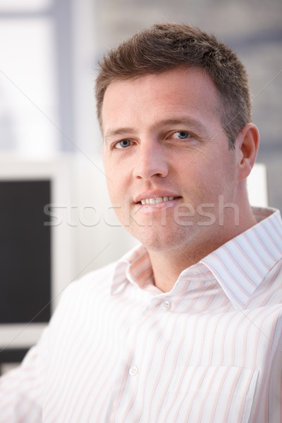 Portrait of middle-aged office worker smiling Stock photo © nyul