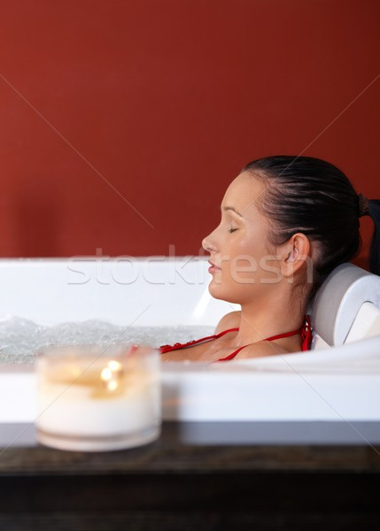 Portrait of woman in jacuzzi Stock photo © nyul