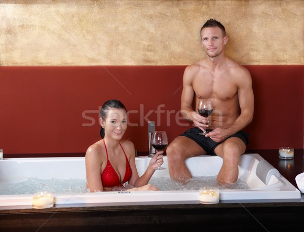 Retrato feliz casal vinho jacuzzi sorridente Foto stock © nyul