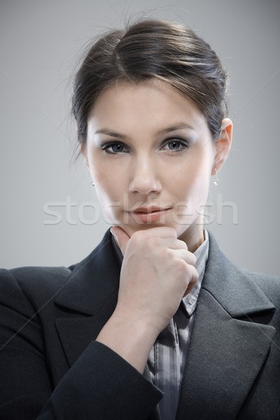 Portrait of thinking young businesswoman Stock photo © nyul
