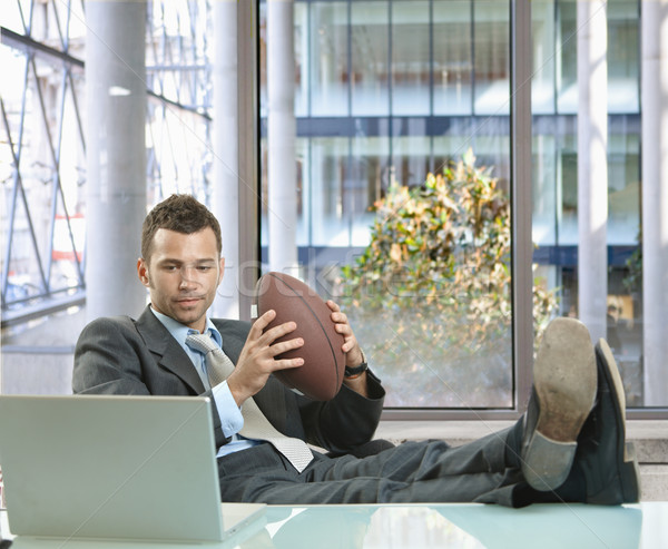 Businessman with football Stock photo © nyul