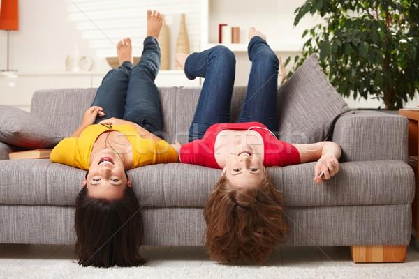 Feliz casa sofá de cabeça para baixo olhando Foto stock © nyul