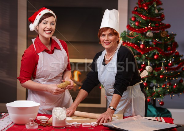 Mother and daughter baking christmas cake Stock photo © nyul