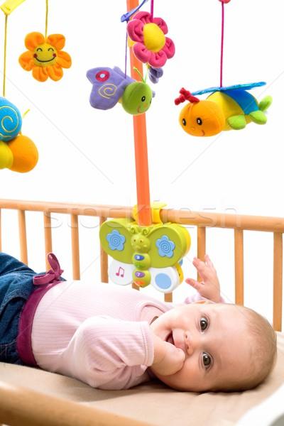 Stock photo: Happy baby on crib