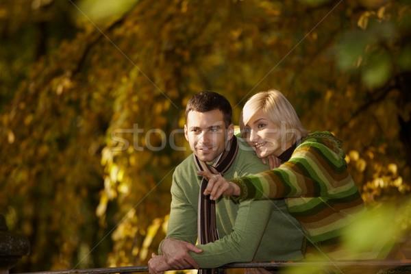 Happy couple in autumn park Stock photo © nyul