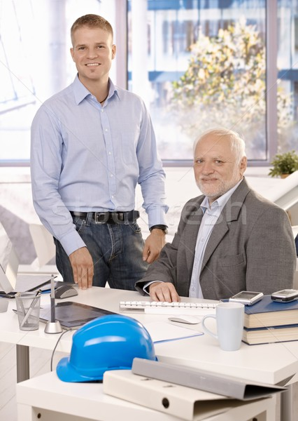 Portrait of senior and junior businessmen Stock photo © nyul