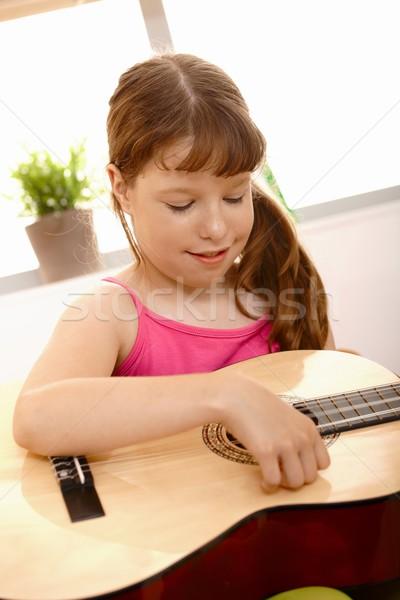 Small girl playing guitar Stock photo © nyul