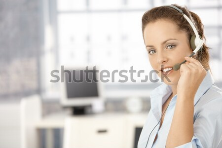 Portrait of attractive girl using headphones Stock photo © nyul